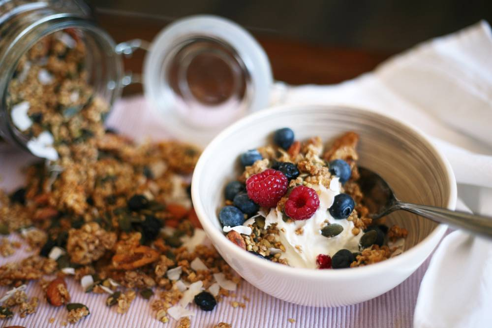 Oat and buckwheat granola with dried blueberries and coconut