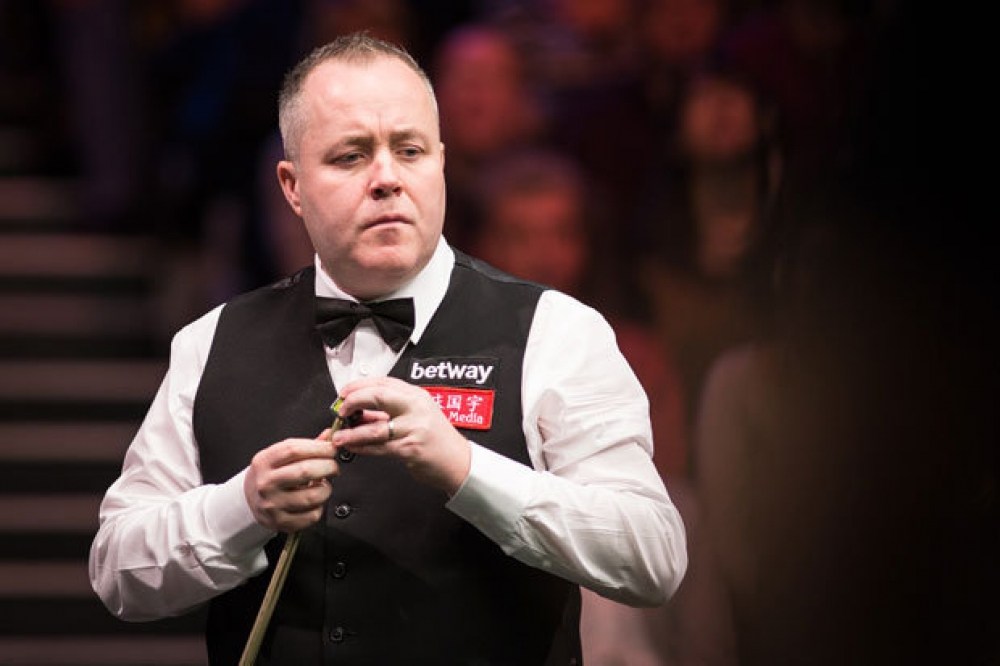 English Open: Higgins eases into second round