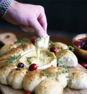 Baked Camembert in a festive bread roll wreath