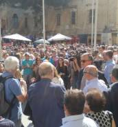 People gather in front of law courts in support of murdered journalist Daphne Caruana Galizia
