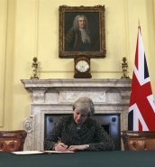 May signs letter that will officially trigger Brexit