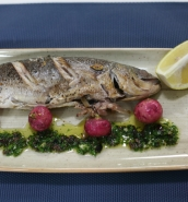 Bay and fennel-stuffed fish with baked radishes