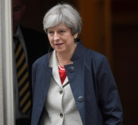 May wins major test in parliament over government plan