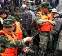 140 feared dead after landslide in China