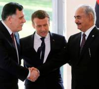 Libya's al-Serraj, Haftar commit to ceasefire at talks in France