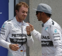 Rosberg snatches pole position from Hamilton