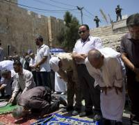Israel insists metal detectors will stay in mosque despite rising violence