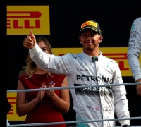 Hamilton triumphs in Italy after Rosberg slip