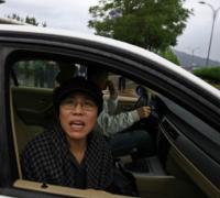China under pressure to free dissident's widow
