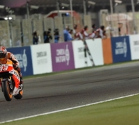 Marquez overcomes Rossi to take Qatar win