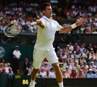 Djokovic brushes Tomic aside