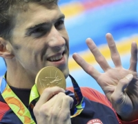 Phelps cruises to 22nd gold
