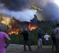 Wildfire-plagued Portugal declares public calamity as 2,000 people trapped