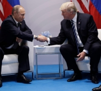 Trump, Putin agree Syria ceasefire, discuss election interference