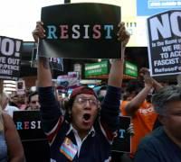 Trump signs memo directing Pentagon to implement transgender ban