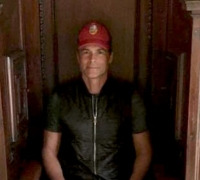Actor Rob Lowe tries on a confessional for size on his Malta film set