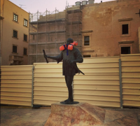 Life jackets over Valletta statues raise awareness on migrants dying at sea