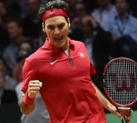 Federer takes Swiss to victory