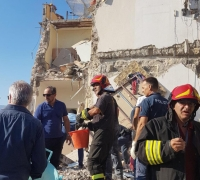 Eight people feared missing after building collapse near Naples
