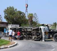 Driver escapes unhurt after truck overturns