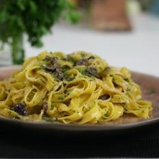 Tagliatelle with orange, black olives and bottarga