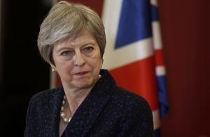British PM delays Brexit vote in parliament