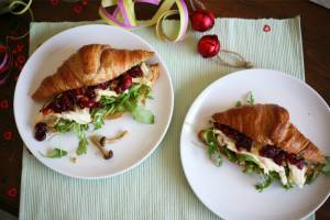 Croissants with fried mushrooms, soft French cheese and cranberry sauce