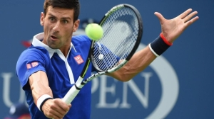 US Open - Novak Djokovic eases into round two