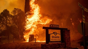 California firestorms leave 2 dead and thousands homeless