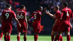 Liverpool beat Tottenham to maintain their perfect record