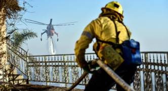 Firefighters persist in battle with Southern California fires