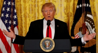 Trump promises overhauled immigration order next week