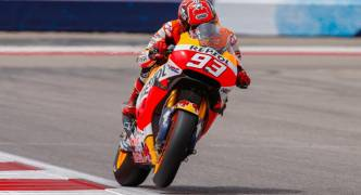 Marquez duels Rossi to take pole at Brno