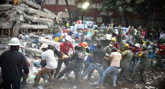 Mexico quake: death toll climbs to at least 230 as volunteers join search for survivors