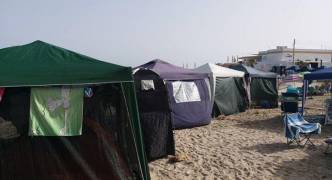 Is this selfish or what? Tents replace deckchairs and umbrellas at Armier