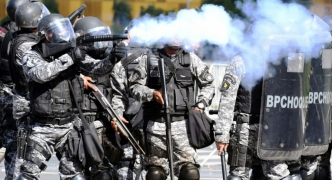 Brazil's Temer orders troops in after protesters trash ministries