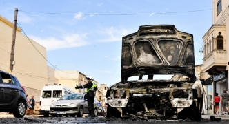 Man escapes burning car with no injuries