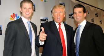 Trump hands over business control to his sons