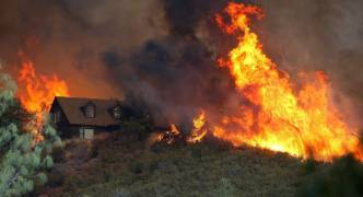 California wildfires: death toll rises to 23 as winds get stronger