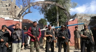Updated   Suicide bombers kill five outside court in north-west Pakistan