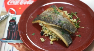 Pan-fried sea bass on a bed of pearl barley