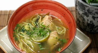 Asian noodle soup with salmon chunks
