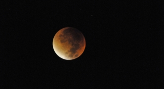 A rare blood moon happened tonight... [PHOTOS]
