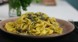 Tagliatelle with orange, black olives and bottarga