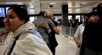 US judge narrows travel ban, handing Trump legal setback
