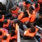 Rescuers save 2,400 asylum-seekers off Libya coast, recover 14 bodies