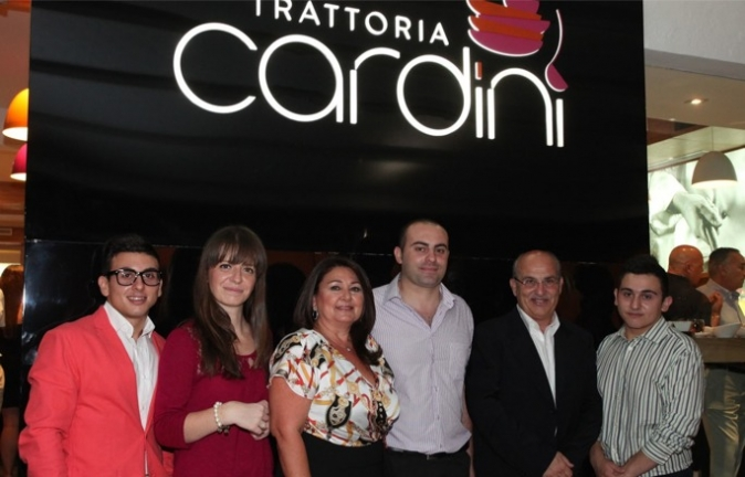The owners of Trattoria Cardini, Architect Joseph Bondin (fifth from left) and his wife Nathalie (third from left) with their sons Jean Karl (left) and Norbert (right) and their two top managers Jeffrey Grech (centre) and Maria Elsworth