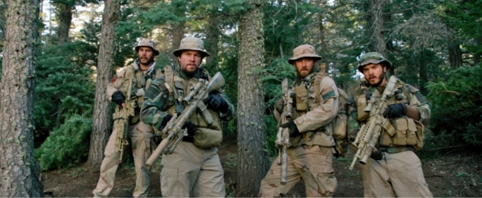 (from left) Michael Murphy (Taylor Kitsch), Marcus Luttrell (Mark Wahlberg), Matt 'Axe' Aelso (Ben Foster), and Danny Dietz (Emile Hirsch) in Lone Survivor (c)  – the incredible story of four Navy SEALs on a covert mission in Afghanistan. Universal Pictures. All Rights Reserved
