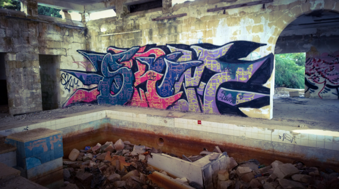 The building is presently abandoned and has been filled with graffiti murals