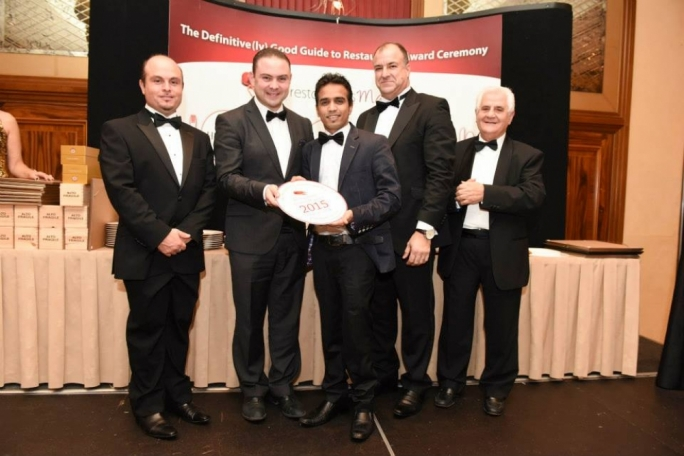 Owner and manager Alan Kawsar (third from left) receiving the award
